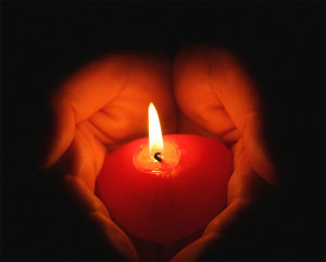 hands-holding-a-candle-300x241